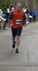 Mike crossing the finish line
