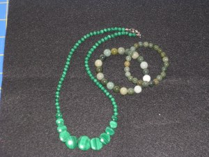 green necklace and jade bracelets