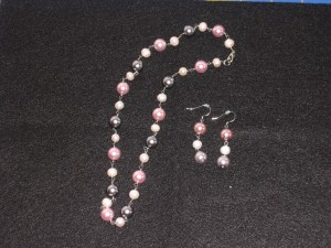 pearl strand and dangling earrings