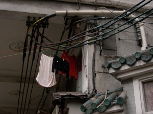 laundry hanging from electrical wiring