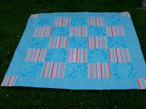 picnic quilt in grass