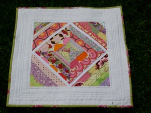 mini string pieced quilt