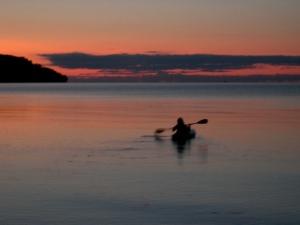 Taylor kayaking at sunset