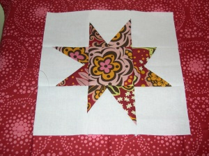 red wonky star block