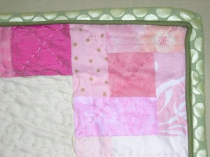 notice the hand quilting and binding