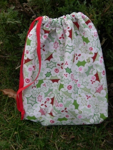 red-green drawstring bag